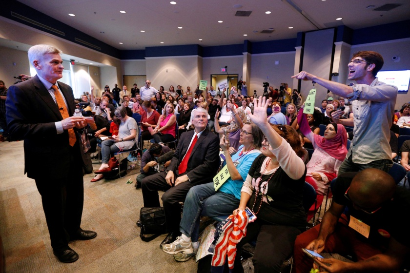 Matthew Schoenberger, of New Orleans, shouts a question at Republican U.S. Senator Bill Cassidy during a town hall meeting in Metairie